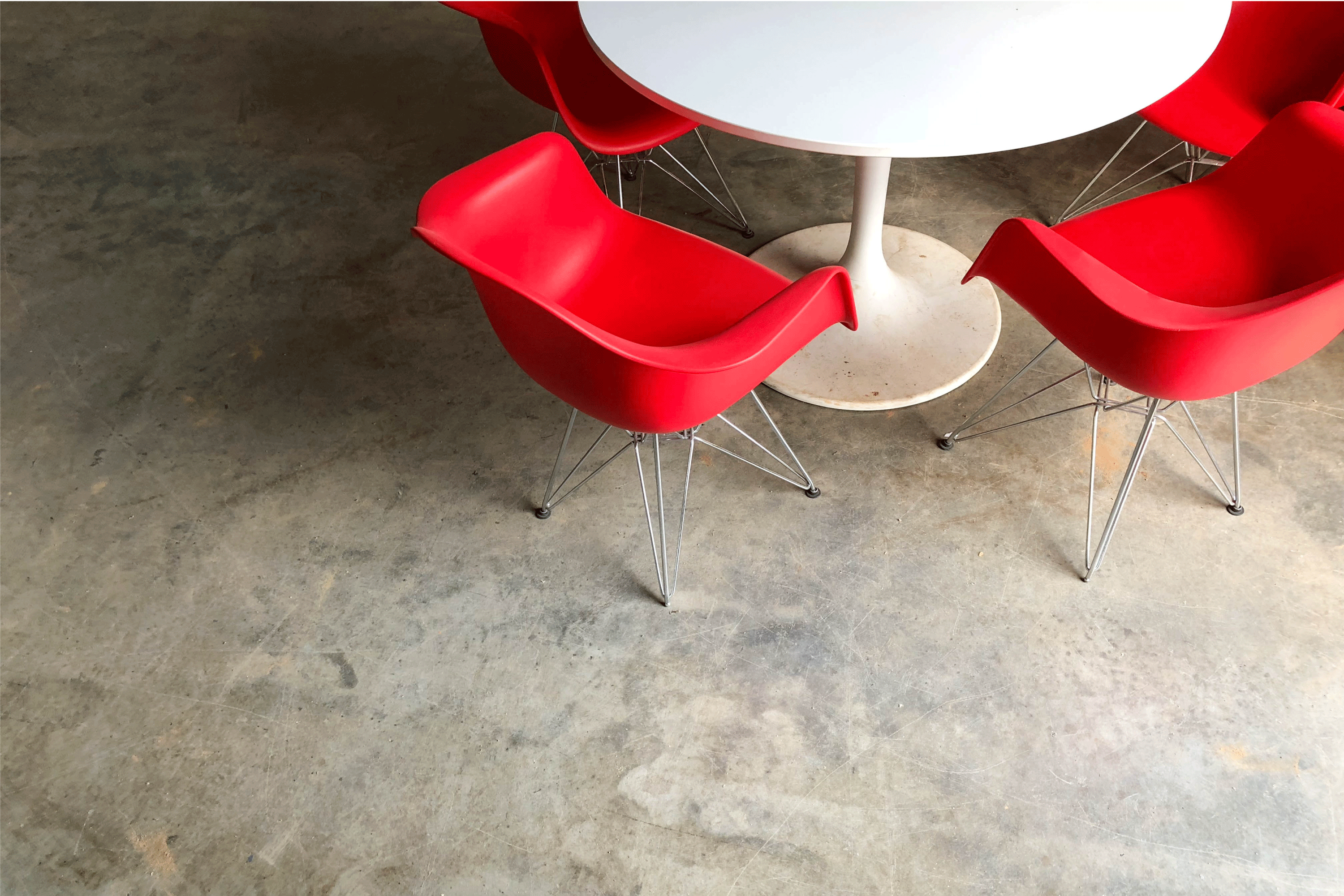 Red chairs at a white table