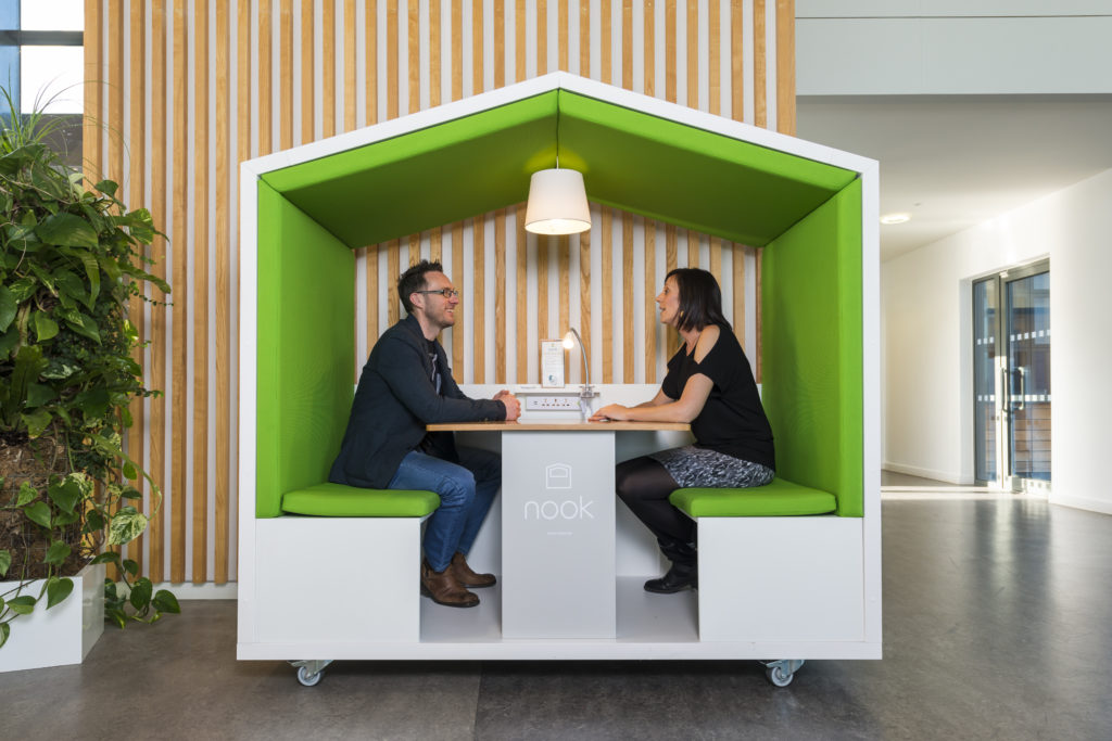 Coworkers working out of a Nook Pod