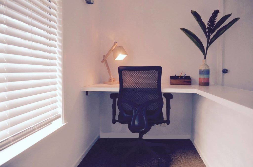 Private desk with lamp and plant at RUA 37