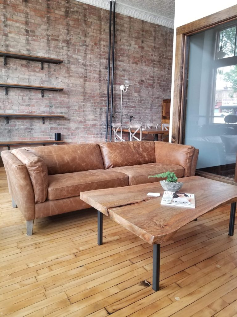 Sitting Area with Live edge table and leather chair at Cornerstone Studios
