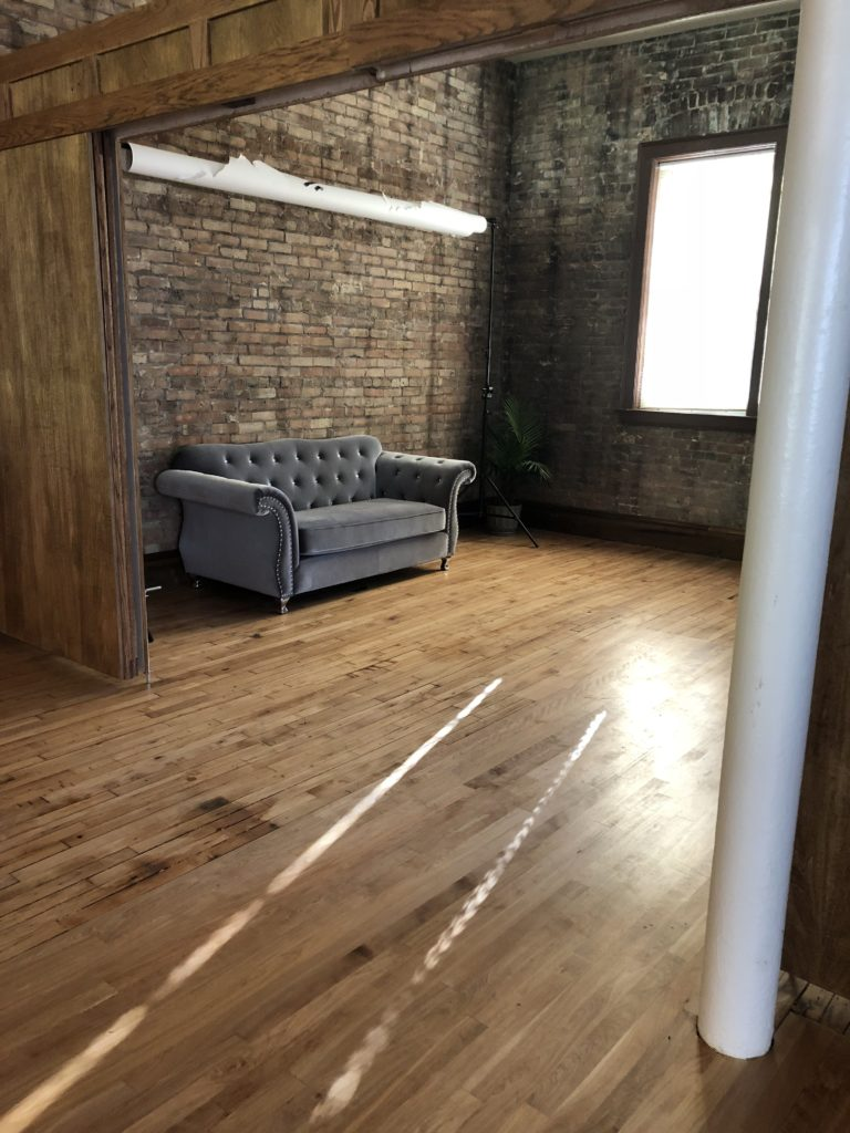 Room with couch and window at Cornerstone Studios