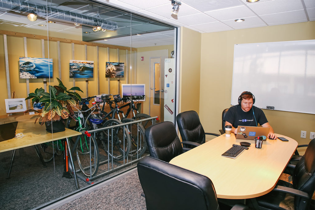 Coworker and bikes in conference room